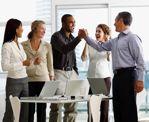 Excited Businesspeople in Meeting --- Image by © Larry Williams/Corbis